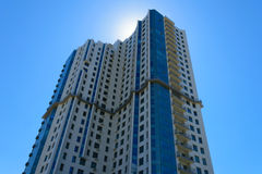 High-rise apartment building. In front of the sunny sky royalty free stock image