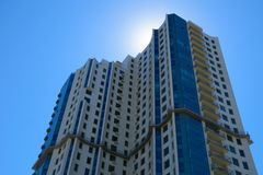 High-rise apartment building. In front of the sunny sky stock photo