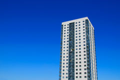 High-rise apartment building. In front of the sunny sky stock photography
