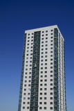 High-rise apartment building. In front of the sunny sky royalty free stock photography