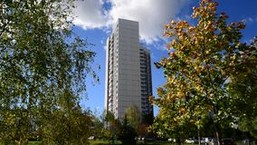 High-rise apartment building surrounded by stock footage