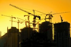 High rise apartment construction. With cranes at sunset time Royalty Free Stock Photography