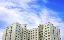 High rise apartments. Top of high rise flats in Ponggol Singapore against a blue sky royalty free stock photo