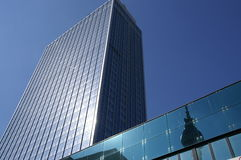 """High-rise in berlin. Formerly: """"hotel of berlin city east""""; under there is a big sport department store; reflection of radio tower berlin stock image"""