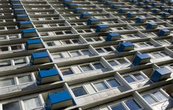High rise block of flats. Exterior of modern high rise block of flats with small blue balconies Royalty Free Stock Photo
