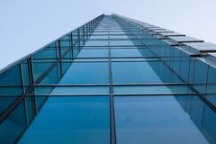High-rise blue office building. With diminishing perspective Royalty Free Stock Photography