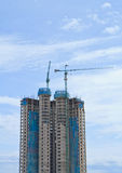 High rise building. Under construction on blue sky background stock images