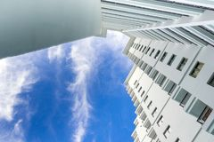 High rise building and bright blue sky. High-rise building and bright blue sky Royalty Free Stock Photo