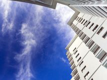 Highrise building and bright blue sky. High-rise building and bright blue sky Royalty Free Stock Image