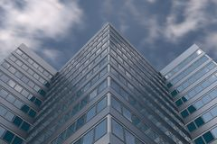 High Rise Building in Cloudy Sky. Beautiful High Rise Building rectangular reflective glass window pattern in Cloudy Sky stock photography