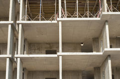 High-rise building construction. A fragment of the facade of the high-rise building under construction technology of reinforced concrete Stock Photo