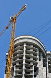 High-rise building. And crane close-up Stock Photography