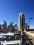 High rise building in downtown. Minneapolis with Mississippi river. View from Central Ave bridge Royalty Free Stock Image