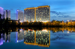 High-rise building and its reflection in water Stock Image