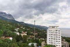 High-rise building among the low-rise buildings of the village of Alupka on the southern coast of Crimea. Cloudy day royalty free stock photo