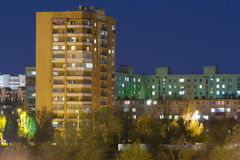 High-rise building in the night sky Royalty Free Stock Photography