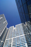 High-rise building reflection in a mirror facade of office build Royalty Free Stock Photos