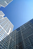 High-rise building reflection in a mirror facade of office build Royalty Free Stock Photo