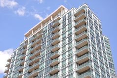 High rise building. High rise residential building in a blue sky royalty free stock photo