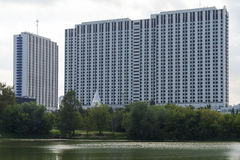 High-rise building by the river in Moscow. High-rise building by the river in Moscow on a summer day Stock Photography