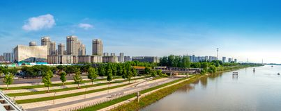 High rise building by the river. High-rise building on the riverside, Nanjing, China royalty free stock photos