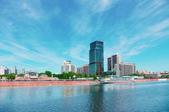 High-rise building on riverbank. Urban landscape Stock Photo