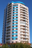 High-rise building round. Building round with balcony on background blue sky Royalty Free Stock Photos