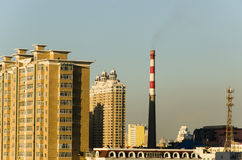 High rise building and Smokestack with Iron tower Stock Photo
