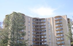 High-Rise Apartment Building. A high-rise building is a tall building, as opposed to a low-rise building and is defined by its height differently in various Royalty Free Stock Image