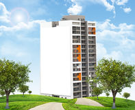 High-rise building under blue sky with road Stock Images