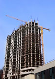 High-rise building under construction and crane Royalty Free Stock Photography
