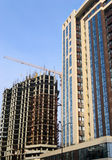 High-rise building under construction and crane Stock Photography