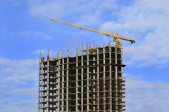 High-rise building under construction and crane Stock Photo