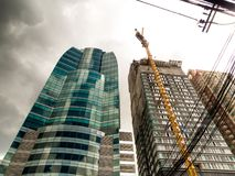 The high-rise building under construction. In the city royalty free stock photo