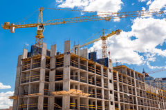 High rise building under construction. High rise building under construction, seen from below against blue sky royalty free stock images