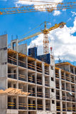 High rise building under construction. High rise building under construction, seen from below against blue sky royalty free stock photography
