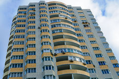 High rise building with yellow balconies. Close up of a high-rise building with yellow balconies. Bottom view Royalty Free Stock Images