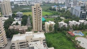 Dark clouds hover over the Landscape of Mumbai Suburb on a rainy day. High rise buildings along the sea coast in the western suburbs Versova, Andheri of Bombay royalty free stock images