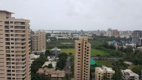 Dark clouds hover over the Landscape of Mumbai Suburb on a rainy day. High rise buildings along the sea coast in the western suburbs Versova, Andheri of Bombay royalty free stock photos