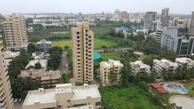 Dark clouds hover over the Landscape of Mumbai Suburb on a rainy day. High rise buildings along the sea coast in the western suburbs Versova, Andheri of Bombay royalty free stock photo