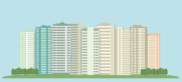 High-rise buildings of the city. And a green field Royalty Free Stock Photography