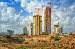 High rise buildings construction site. Bat Yam, Israel-May 27, 2016: View on part of the Sea Park huge real estate project. Some cranes work over new high-rise royalty free stock image