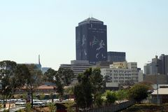 Downtown skyline with a taxi rank in the foreground in Johannesburg Stock Photo