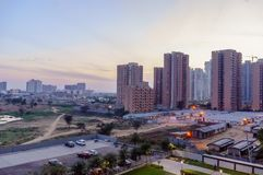 High rise buildings in gurgaon delhi NCR shot at dusk. The smaller buildings and car parking areas showcase the quick development in real estate royalty free stock photos