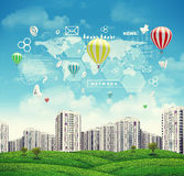 High-rise buildings over green hills, few air Royalty Free Stock Photos