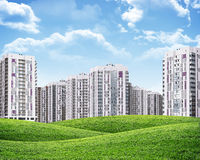 High-rise buildings over green hills Stock Image