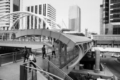 High-Rise buildings and a sky walk at Sathorn-Narathiwas intersection in Bangkok Stock Photography