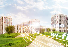 High-rise buildings under cloudy blue sky. With lines and words, road and trees Stock Images