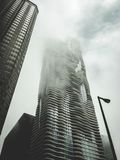 High Rise Buildings Under Cloudy Sky Royalty Free Stock Photography