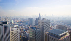 High rise city. Tokyo Japan, High rise architecture. Glass, concrete, and steel building. A twin tower office building in a business district. High rise as far royalty free stock photo